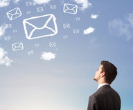 Man looking at mail symbol clouds on blue sky Royalty Free Stock Images