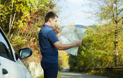 Man looking on map Stock Photography