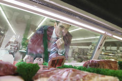 Man Looking At Meat In Supermarket Royalty Free Stock Images