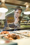 Man Looking At Meat In Supermarket Royalty Free Stock Photos