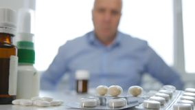 Man Looking for Medical Pills in Pharmacy stock photos