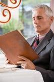 Man looking at a menu Stock Photography