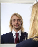 Man looking in a mirror Stock Image