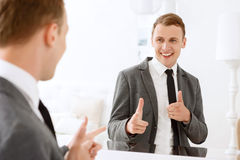 Man looking in mirror and pointing on himself Stock Image