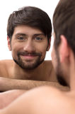 Man looking at mirror. Royalty Free Stock Photo