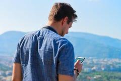 Man looking at mobile phone in Marina Grande Sorrento. Man looking at mobile phone in Marina Grande in Sorrento, Tyrrhenian sea, Amalfi coast, Italy Royalty Free Stock Photo
