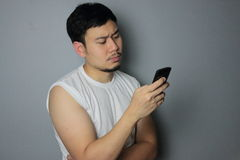 A man is looking on the mobile phone. A man is thinking after he got a message stock images