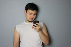A man is looking on the mobile phone. A man is thinking after he got a message stock photos