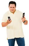 Man looking at mobile phones Royalty Free Stock Images