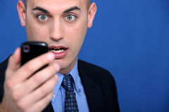 Man looking at mobile telephone Royalty Free Stock Images