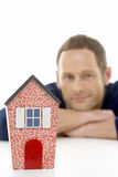 Man Looking At Model House Stock Photography