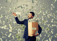 Man looking at money Royalty Free Stock Images