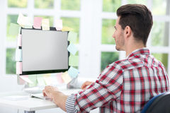 Man looking at a monitor with sticky note on it. Man looking at a computer monitor with sticky note on it stock images