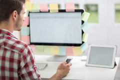 Man looking at monitor with sticky note stock photos
