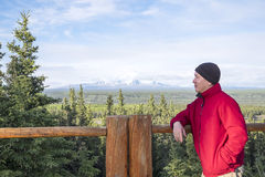 Man Looking at Mountain View in Alaska Stock Photo