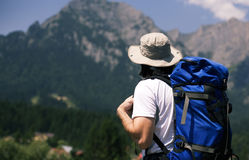 Man looking at the mountains Stock Photography