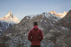 Man looking at mountains