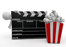 Man looking through the movie clapper and popcorn Royalty Free Stock Image