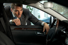 Man looking at new car Stock Image
