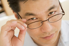 Man Looking Through New Glasses Royalty Free Stock Images