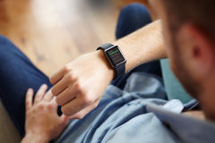 Man Looking At News Application Software On Smart Watch Stock Photos