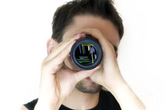 Man looking in an objective Royalty Free Stock Photography