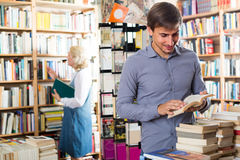 Man looking at open book Stock Photo