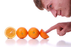 The man looking at oranges. The man looking at perfectly fresh oranges, on white background Royalty Free Stock Photos