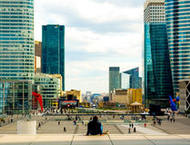 Man looking out across La Defense to L'Arch de Triumph, Paris Stock Image