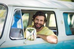 Man looking out of camper van window Stock Photo