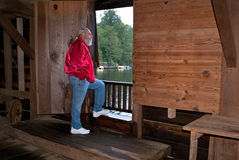 Man looking out doorway of Watsons Mill covered br Stock Photos
