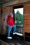 Man looking out doorway of Watsons Mill covered br Royalty Free Stock Photography