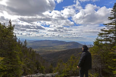Man looking out from elevation on Mount Washinton via Ammonoosuc. Ravine trail in Coors County,  New Hampshire Stock Image