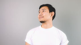 A man looking out and smile like day dreaming. Stock Image