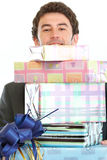 Man looking out from stack of gift boxes Royalty Free Stock Photo