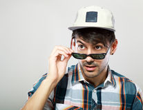 Man looking over glasses. At something outside the picture Royalty Free Stock Photo