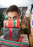 Man Looking Over Stacked Christmas Gifts In Store Stock Photos