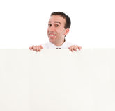 Man Looking Over Wall Stock Photo