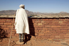 A man looking over a wall, Ethiopia Stock Image