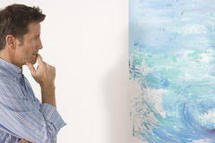 Man Looking At Painting In Art Gallery Royalty Free Stock Photos