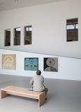 Man looking at the painting in gallery Danubiana, Bratislava stock image