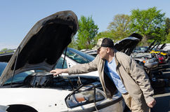 Man is looking for parts on a junk yard Stock Photography
