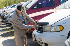 Man is looking for parts on a junk yard Stock Image