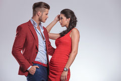 Man looking with passion at his woman. Man looking with passion at his women and holds her close royalty free stock photography