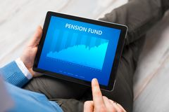 Man looking at pension fund performance graph on tablet computer. Royalty Free Stock Photo
