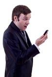 Man looking at phone astonish Stock Image