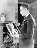 Man looking at picture of woman Royalty Free Stock Photos