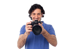 Man looking at pictures stored in camera Royalty Free Stock Photo