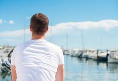 Man looking on pier. Stock Image