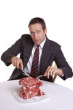 Man looking with pile of steaks Royalty Free Stock Photos